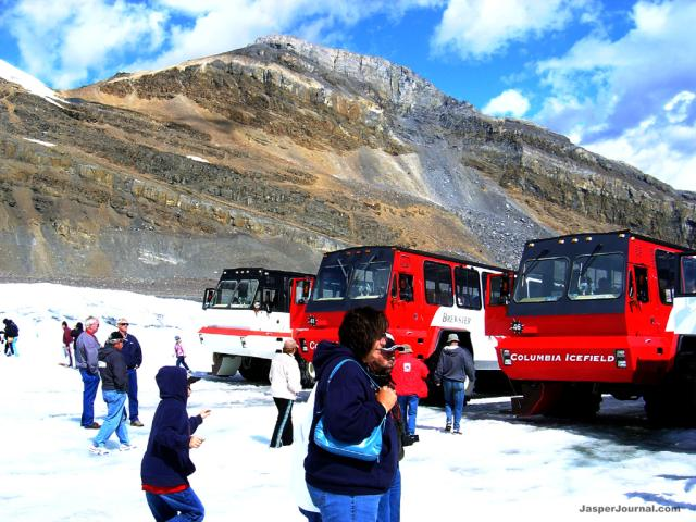 Tourist and 4X4 Buses on the Glacier Photo